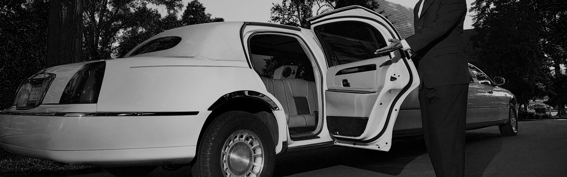 Airport Pick-up Limousine Service (white limo)